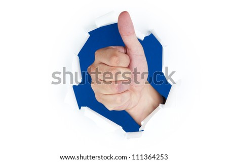 Thumb up through paper