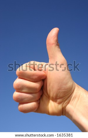 Thumbs up against a blue sky