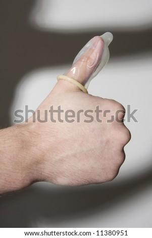 thumbs up, condom on thumb,