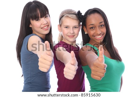 Thumbs up for success by three multi cultural teenage school student friends made up of mixed race african american, oriental Japanese and caucasian all happy holding hands out to camera.