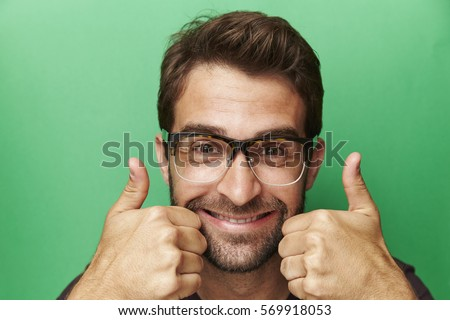 Thumbs up guy smiling at camera