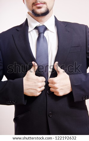 Thumbs up in beige background