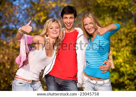 Thumbs up (one man and two women)