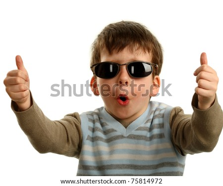 Thumbs up shown by a happy young boy on glasses, isolated on white