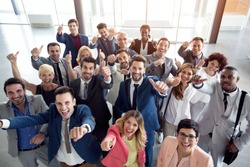 thumbs up smiling business people