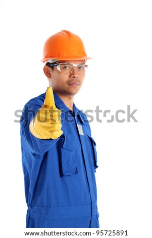 Thumbs up worker with a safety helmet , isolated on white