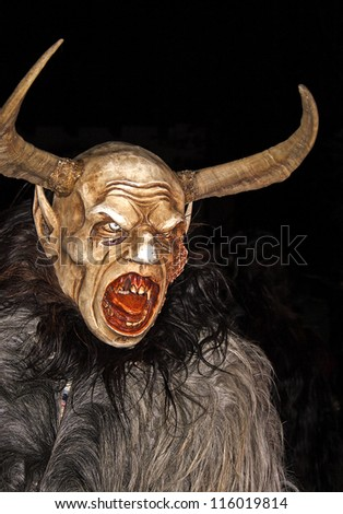THUMERSBACH, AUSTRIA - DECEMBER 4: Unidentified man wears Krampus (devil) mask at traditional procession on December 4, 2006 in Thumersbach.
