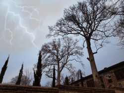 thunder above the huge trees in front of sheki khan saray