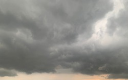 Thunder cloud, Nimbostratus Clouds A gray Style rolls are round to each other in sheets or layers and Huge scary storm it's going to rain heavily at Thailand.no focus