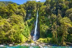 Thunder Creek Falls In Haast Pass New Zealand, Beautiful Waterfall Landscape In Lush Green Forest Environment, South Island NZ, Popular Travel Destination,