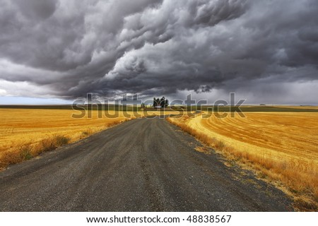 Thunder-storm above Montana. Fields after a harvest and road