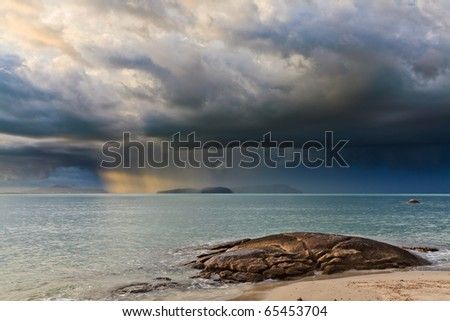 Thunder storm with roll cloud approaching the tropical beach