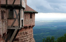 Thunderclouds over Castle Haut-Kœnigsbourg (Château du Haut-Kœnigsbourg), a medieval castle located in the Vosges mountains, Alsace, France overlooking the Upper Rhine Plain to the Black Forest
