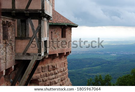 Thunderclouds over Castle Haut-Kœnigsbourg (Château du Haut-Kœnigsbourg), a medieval castle located in the Vosges mountains, Alsace, France overlooking the Upper Rhine Plain to the Black Forest  Photo stock ©