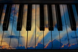 Thunderous sky with clouds during sunset on the keys musical instruments piano, grand piano, synthesizer, concept of melody
