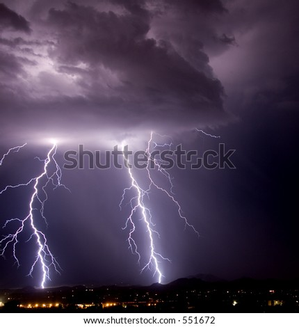 Thundershower and lightning over city and mountains