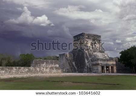 thunderstorm and sun under mayan ruins Chichen Itza Mexico