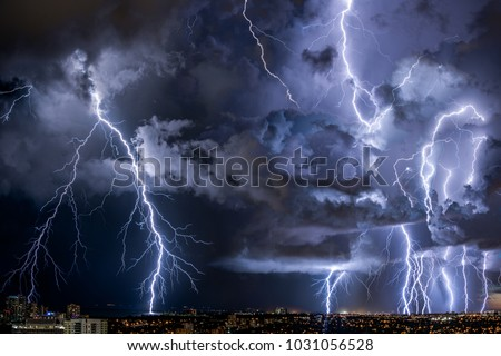 thunderstorm bolts passing through city
