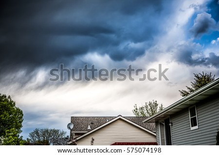 Thunderstorm clouds over suburban houses