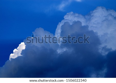 thunderstorm cloudscape with dark cumulus clouds against blue sky #1506022340