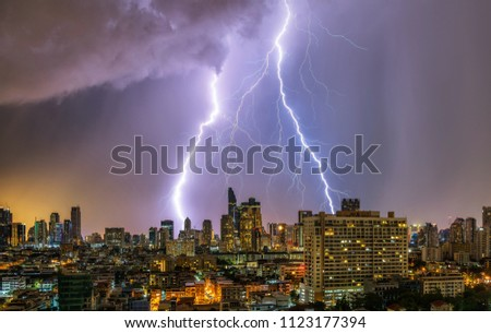 Thunderstorm in Bangkok city downtown at summer evening
