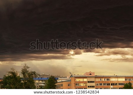 Thunderstorm looming over the city. Picture of approaching storm