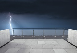 Thunderstorm on the balcony. Balcony view of  the sky with thunder at night. Landscape. Terrace with a beautiful view of the storm. Background with landscape. Storm in the night.
