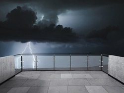 Thunderstorm on the beautiful balcony. Balcony view of  sky with thunder. Landscape. Night. Terrace with a beautiful view of storm. Background with beautiful landscape. Storm in the night.