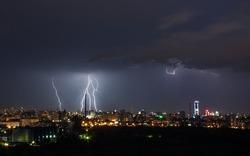 thunderstorm over night city