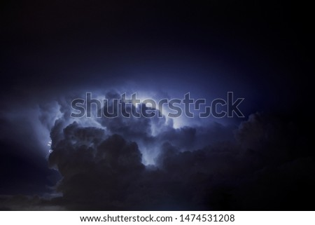 Thunderstorm. Picture of clouds illuminated, light in the sky.