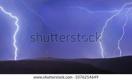 Stock Photo Thunderstorm with giant and strong lightnings. On the top of the mountain.