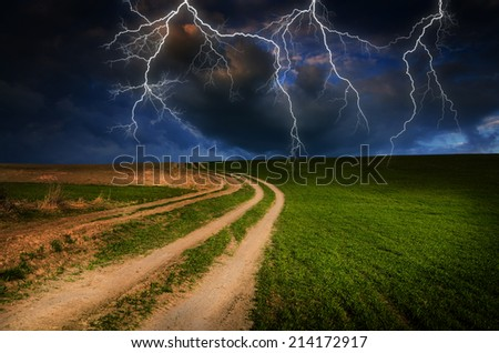 Thunderstorm with lightning in dirt road.