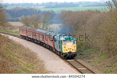 THUXTON, UNITED KINGDOM - MARCH 20: Preserved diesel locomotive D5557 takes passengers on short pleasure trips as part of the Mid Norfolk Railways summer steam gala on March 20, 2011 at Thuxton, UK.