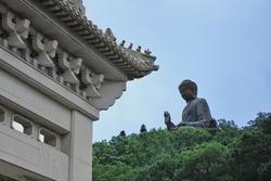 Tian Tan Buddha in Ngong Ping, the popular landmarks of Hong Kong. The big Statue of Buddha on top of mountain.