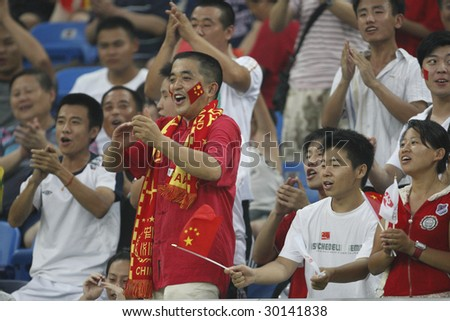 TIANJIN, CHINA - AUGUST 6:  Chinese supporters cheer their team prior to the start of a women's soccer match between China and Sweden at the Beijing Olympic Games August 6, 2008 in Tianjin, China.