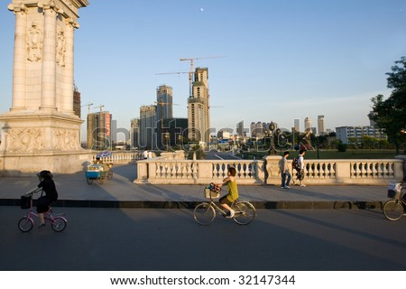 TIANJIN, CHINA - JUNE 3: Cyclists go home after work in one of China\'s largest city June 3, 2009 in Tianjin, China.