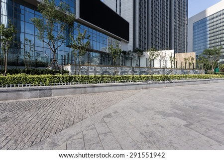 Tianjin,China-May 22,2015:urban building with cement floor road in tianjin.