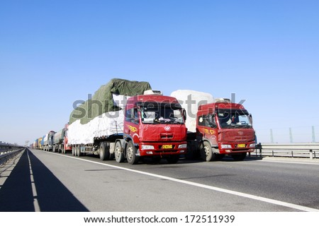 TIANJIN - DECEMBER 9: heavy duty trucks stopped on the highway Because of the traffic jam, on December 9, 2013, tianjin, China.   #172511939