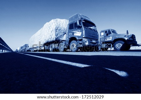 TIANJIN - DECEMBER 9: heavy duty trucks stopped on the highway Because of the traffic jam, on December 9, 2013, tianjin, China.