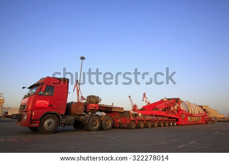 TIANJIN PORT - MARCH 22: a multi-axis heavy-duty truck parked in the terminal yard, on March 22, 2015, tianjin port, tianjin, China.