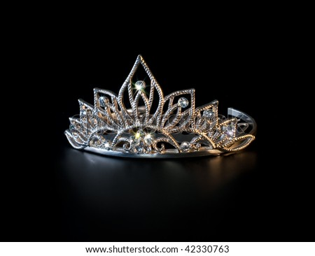 Tiara or diadem with colorful sparkles on black background
