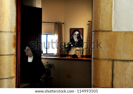 TIBERIAS,ISRAEL - JANUARY 13:A nun inside the Roman Catholic chapel at Mount of Beatitudes on January 13 2011.It believed that this is where Jesus delivered the Sermon on the Mount.