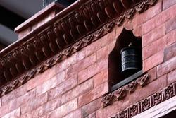 Tibetan bell decoration in monastery wall ,Nepal
