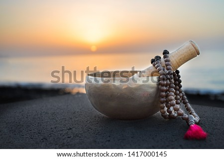 Tibetan bowl with mala beads on nature seaside background for meditation and mindfulness Stock photo ©