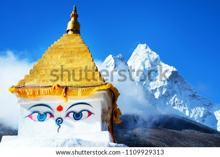 Tibetan buddha Stupa and trekker with Mount Everest background near Namche bazaar Nepal
