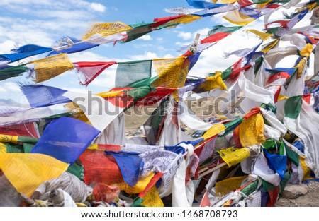 "Tibetan Buddhism prayer flags (lungta) with prayer mantra ""Om mani padme hum"" in tibetan language. Leh, Ladakh, Jammu and Kashmir, India"