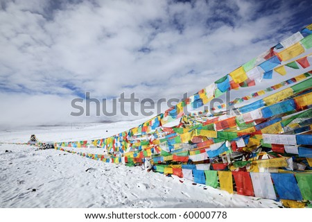 tibetan prayer flags under moody sky, tibet.