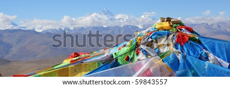 tibetan prayer flags with mount everest in the background, tibet.
