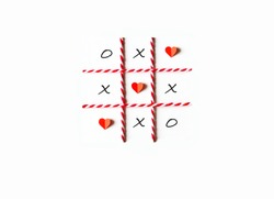 Tic tac toe game or noughts and crosses.  Red heart shaped and grid line made from paper cut,red-white rope.Flat lay,top view and white isolated.Minimal love concept.Copy space for text.Easy to use.