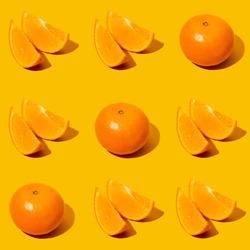 Tic tac toe sweet fruit game. Fresh mandarine Seamles fine pattern. Ripe fruit tangerines. Fresh citrus isolated on orange background pattern. Flat lay of Clementine. Close up